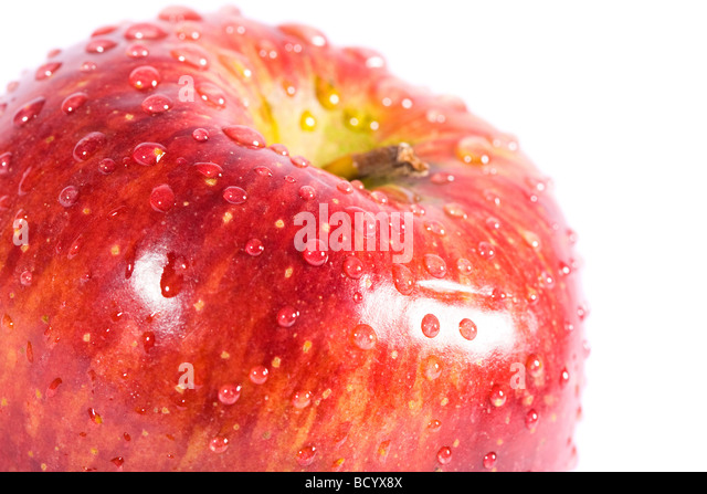 Red apple with water drops Isolaed on white - Stock Image