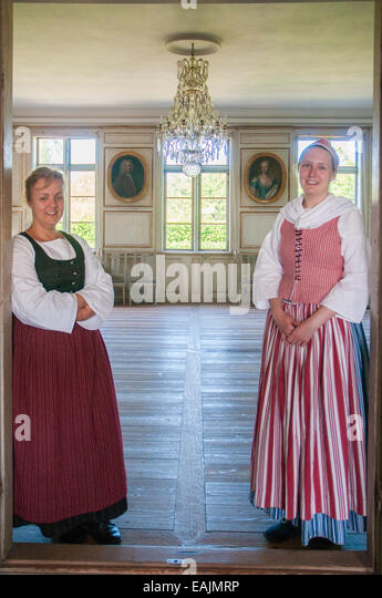 Costumed hostesses at Skogaholm Manor, a noble family's country estate re-created at Skansen Folk Village, Stockholm - Stock Image
