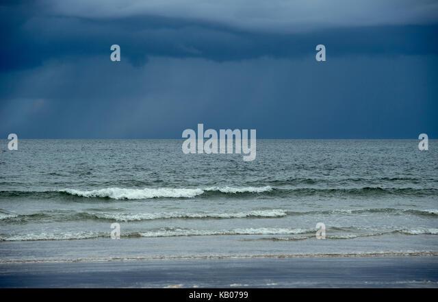 Moody skies over the beach at Portstewart Strand, County Antrim, Northern Ireland - Stock Image