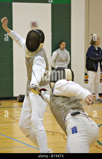 SPORTS Gurnee Illinois USFA sectional fencing competition two male competitors in match - Stock Image