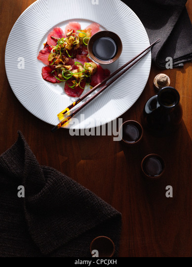 Plate of steak carpaccio with sauce - Stock Image
