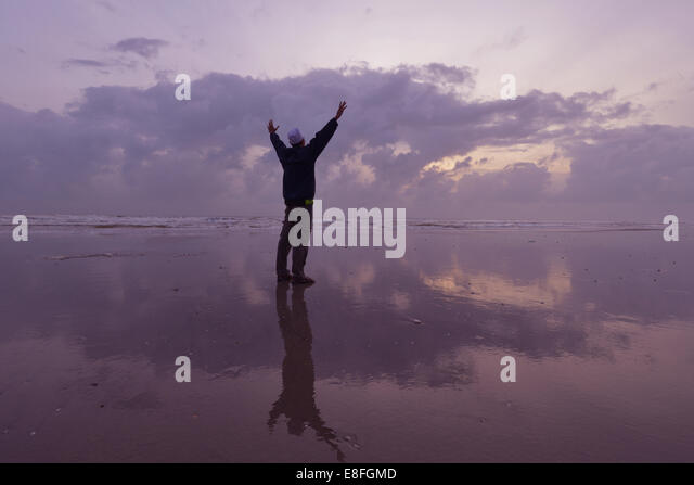 Malaysia, Kuantan, Silhouette of man on beach at morning day - Stock Image
