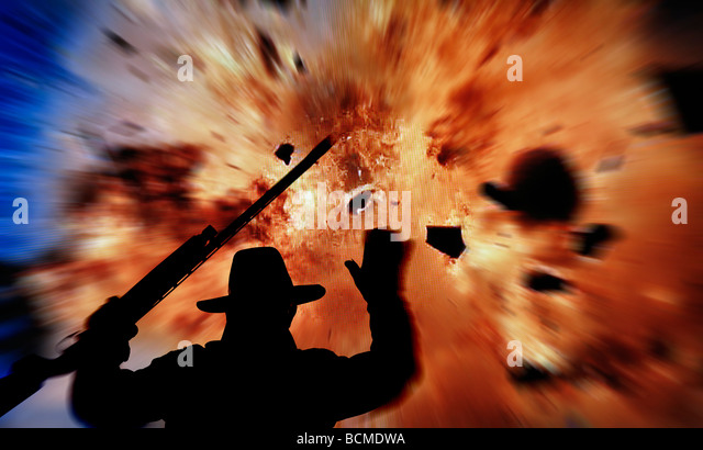 silhouette of man with gun running from huge explosion - Stock Image
