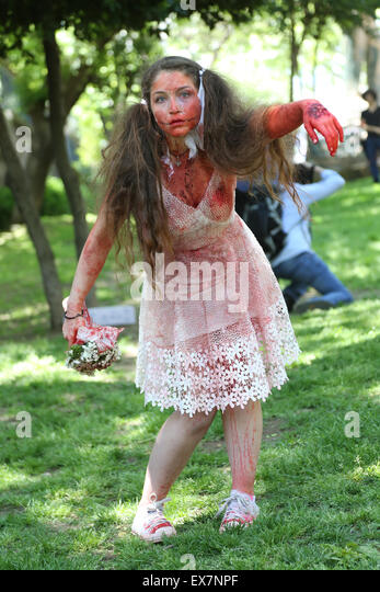 girl wedding dress during zombie walk Istanbul Nisantasi Park - Stock Image