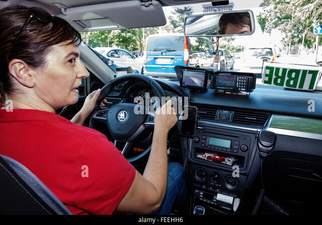 Madrid Spain Europe Spanish Hispanic Centro Retiro Paseo del Prado Plaza de las Cortes woman taxi cab driver job - Stock Image