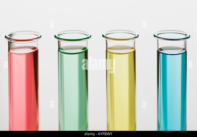 Multi-colored liquids in vials - Stock Image