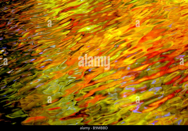 Reflection of Fall Colors in Water - Stock Image