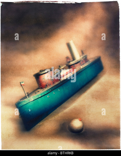 old wooden toy boat. Polaroid transfer - Stock Image
