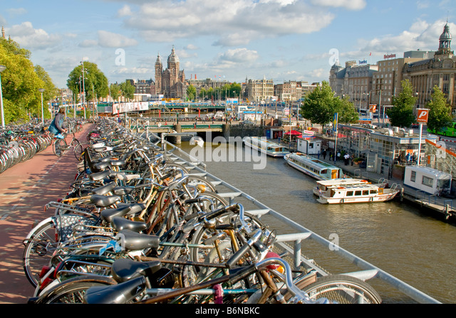 Amsterdam multistory bicycle parking lot along canal near Centraal Station - Stock Image