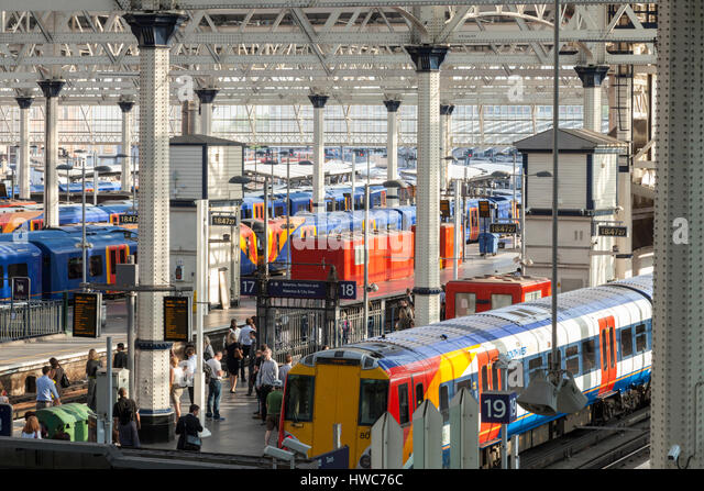 Passengers and trains at Waterloo Railway Station, London, England, UK - Stock Image