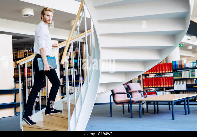 To climb the ladder you have to have knowledge and to have knowlade you have to study in a library - Stock Image