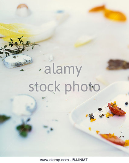 Remains of chicory, strawberries and goat's cheese - Stock Image