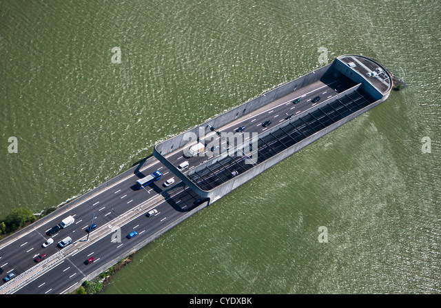 The Netherlands, Amsterdam, Access of Zeeburgertunnel, connecting the south and north of the city. Lake Het IJ. - Stock-Bilder