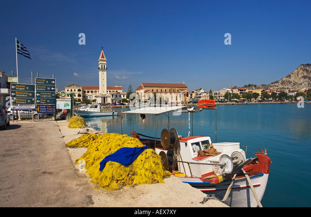 Zakynthos town harbour fishing boat background Agios Dionysios church - Stock Image