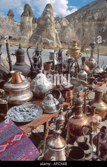Turkey Cappadocia Zelve Valley souvenir pots & kettles fairy chimney volcanic tufa mounds beyond - Stock Image