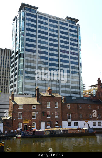 Contrasting architecture old and modern city office buildings Birmingham canals waterways narrowboats at Broad Canal - Stock Image