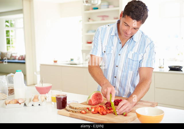 Man Preparing Healthy Breakfast In Kitchen - Stock Image