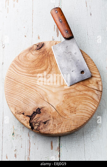 Meat cleaver on blue wooden background - Stock Image