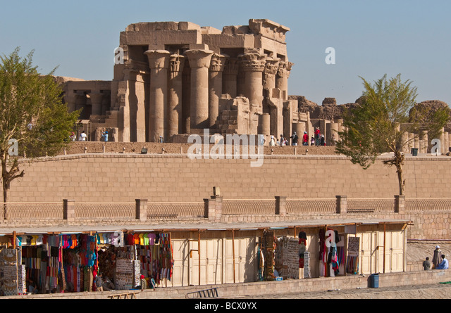 Egypt Kom Ombo Temple with souvenir seller shops that line bank of the Nile - Stock Image