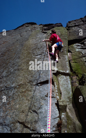 Rock climbing on Curbur Edge Peak District National Park Derbyshire - Stock Image