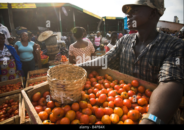 Tomato vendor at Agbogboloshie market in Accra Ghana - Stock Image