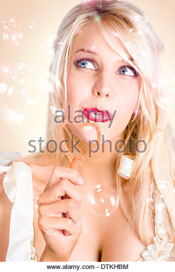 Wedding guest celebrating a union of love - Stock Image