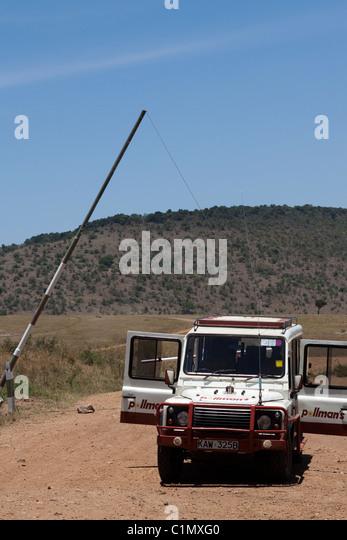 A Land Rover on safari in the Masai Mara, Kenya, Africa - Stock Image