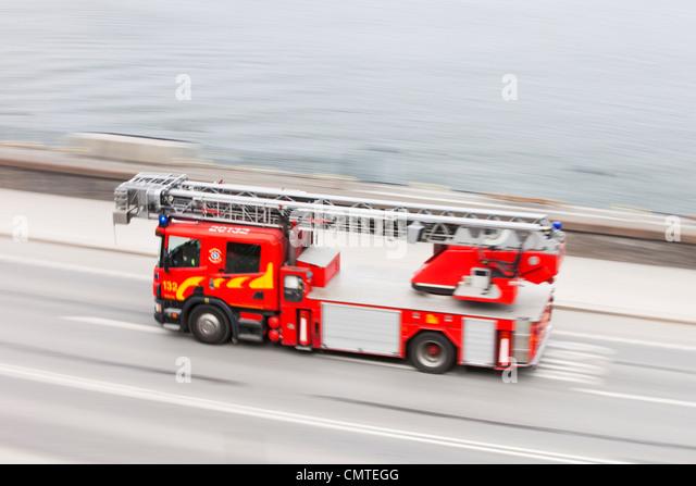 Emergency vehicle at full speed - Stock Image