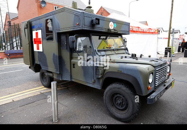 land rover battlefield ambulance at british army medical regiment recruiting stand at an outdoor event - Stock Image