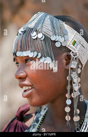A Maasai girl from the Kisongo clan wearing an attractive beaded headband. - Stock Image