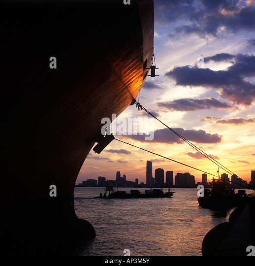 Container ship docked in Port of Miami in the evening - Stock Image