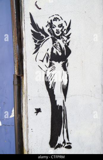 Spray paint stencil by graffiti artist Pegasus in Islington, London depicting Marilyn Monroe with angel wings - Stock Image