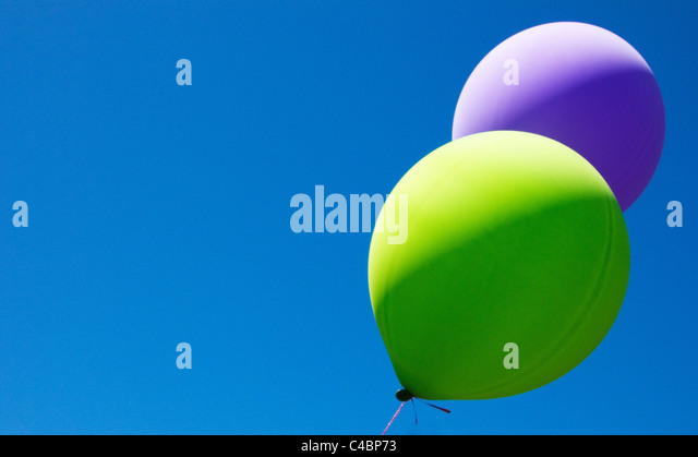 balloons blowing in the wind - Stock Image