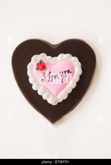 Valentine chocolate heart on a white background. - Stock Image