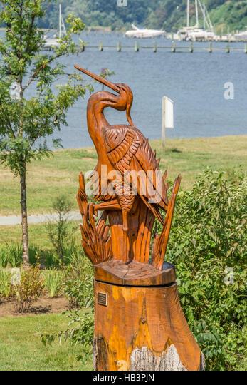 Bird wooden carving stock photos