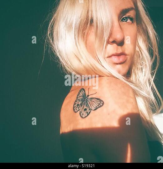 Butterfly on my shoulder - Stock Image