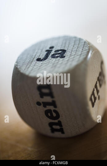 Dice for Decision Making (German) - Stock Image