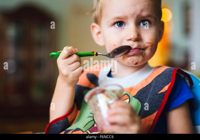 Smeared child eating - Stock-Bilder