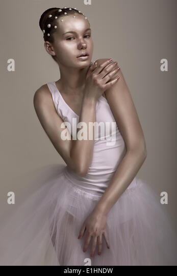 Extravagance. Performance. Glossy Woman with Bright Brown - Silver Makeup - Stock Image