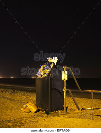 Public bin at night - Stock Image