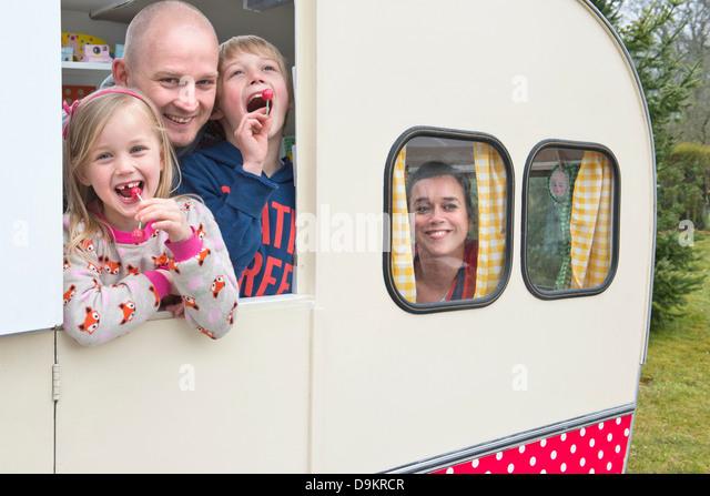 Portrait of family in caravan - Stock-Bilder