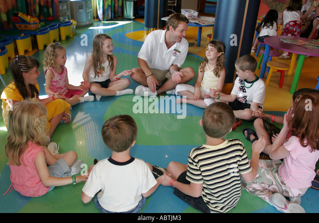 Puerto Rico Atlantic Ocean Holland America Line ms Noordam Club HAL children male counselor game hold hands - Stock Image