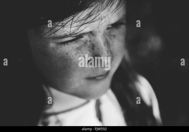 Close-Up Of Thoughtful Girl Looking Away - Stock Image
