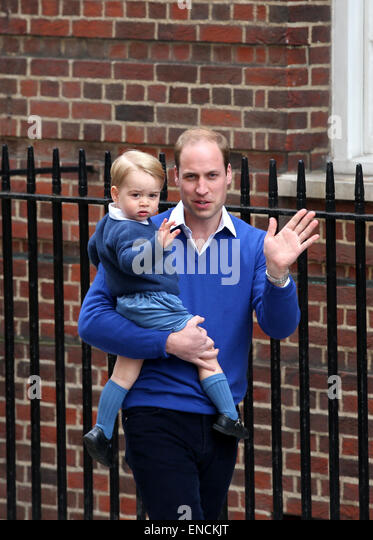 London, London, UK. 2nd May, 2015. Prince William, Duke of Cambridge, holding Prince George arrive at St. Mary's - Stock Image