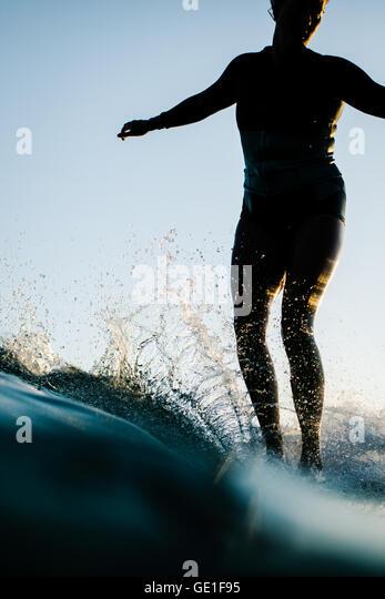 Close-up of woman surfing, Malibu, California, America, USA - Stock Image