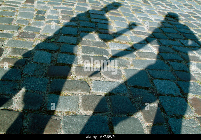 Shadows of two people fighting - Stock Image