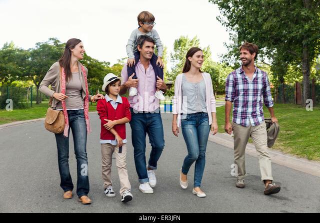 Family walking together in street - Stock-Bilder