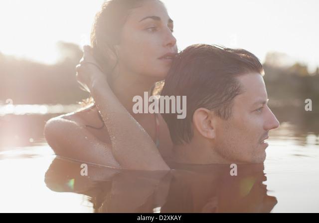 Close up of serene couple swimming in lake - Stock-Bilder