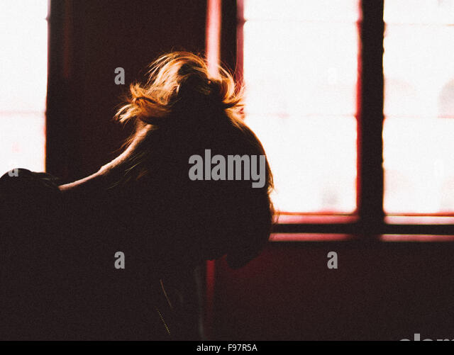 Silhouette Of Depressed Woman - Stock Image