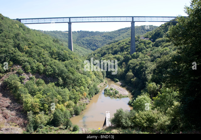 Railway line crossing the River Sioule, the Avergne, France. - Stock Image